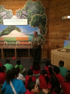 A docent at the Nature Center teaches a group of young children about turtles.
