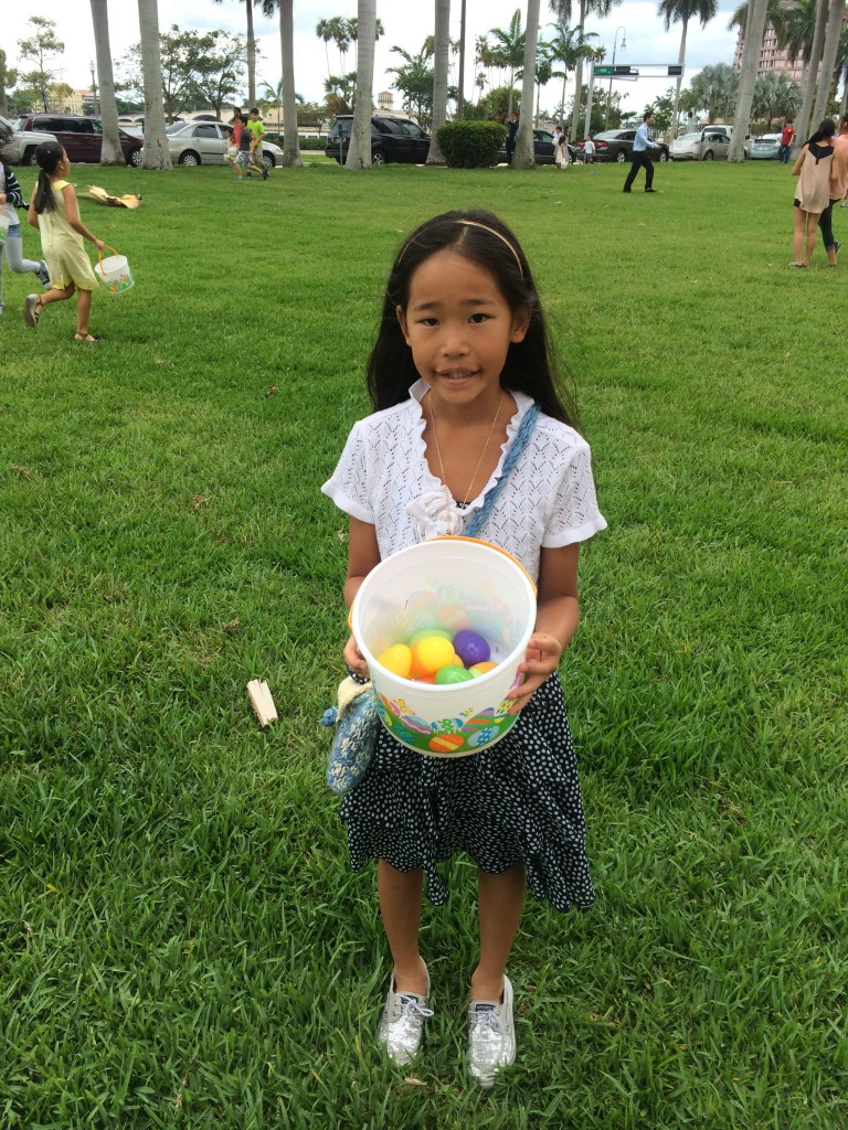 Happy girl showing us her Easter eggs.