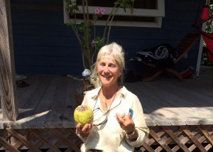 Leslie with ripe breadfruit in right hand, and fresh egg from the hen house in left hand