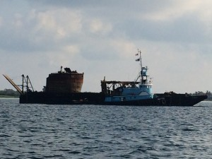 Barge at Whale Cay Channel with remains of ship wreck
