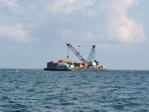 Barge at Whale Cay Channel with crane used to bring up pieces of ship wreck