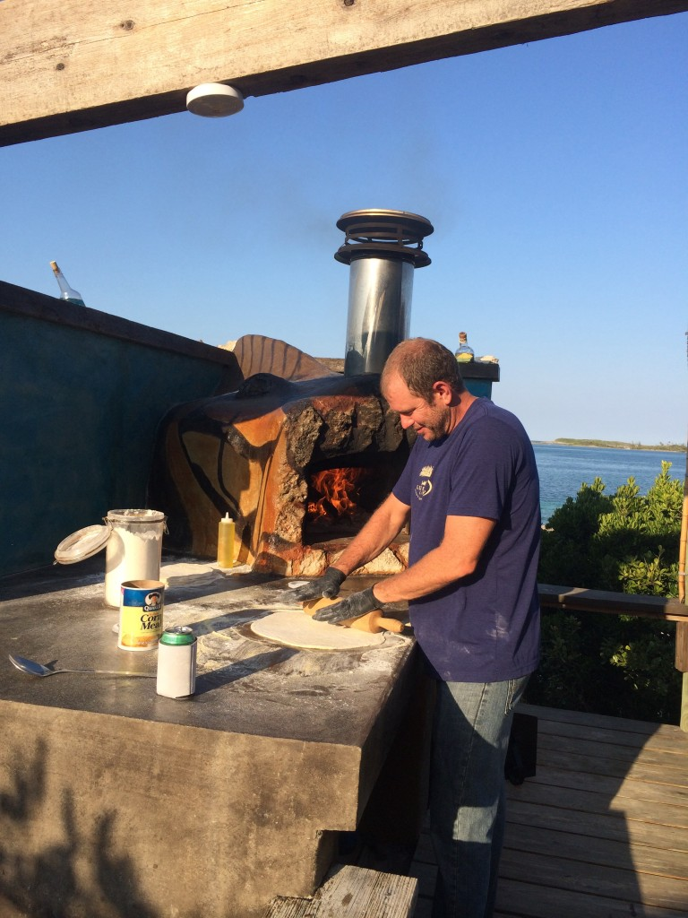 Owner of Lubbers Landing, Austin, and his new pizza oven