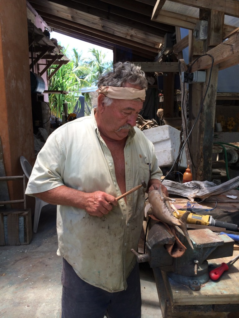 Pete, hard at work in the foundry, working on a fish sculpture