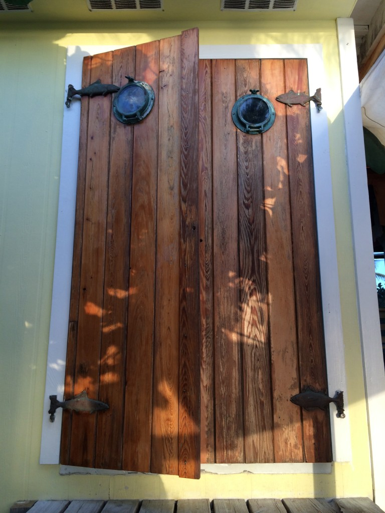 Doors to the kitchen with fish shaped hinges and porthole windows